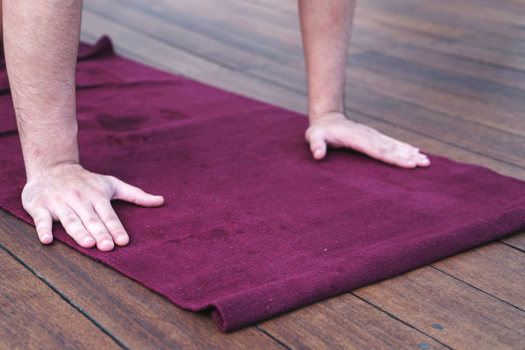 Man doing yoga pose on the mat