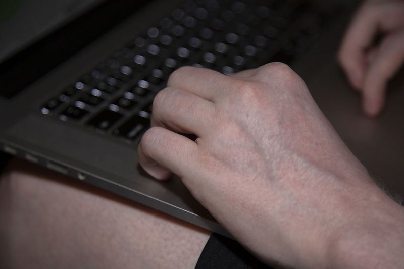 Man typing on a
