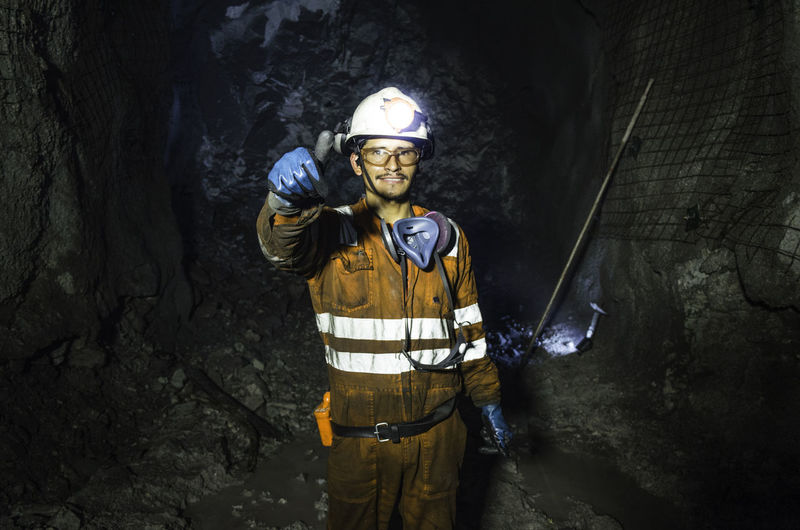 Portrait of man standing in tunnel