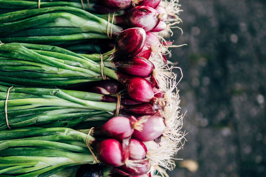 some onions The Week On EyeEm Artichoke Bunch Choice Close-up Day Food Food And Drink Freshness Healthy Eating Large Group Of Objects Market No People Outdoors Raw Food Turnip Variation Vegetable