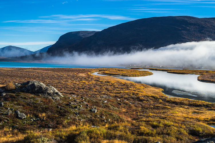 September hiking along The King's Trail in northern Sweden Abisko Autumn Blue Day Fall Fog Hiking Kungsleden Landscape Laponia Mist Morning Mountain Nature No People Northern Europe Outdoors River Rock Formation Scandinavia September Sky Stream The Kings Trail Water
