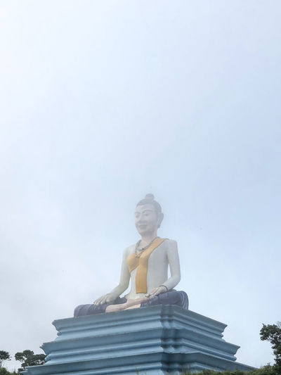 Buddha in the clouds, near Kampot Cambodia Buddha Statue Buddhism Low Angle View Place Of Worship Religion Sky Spirituality Statue