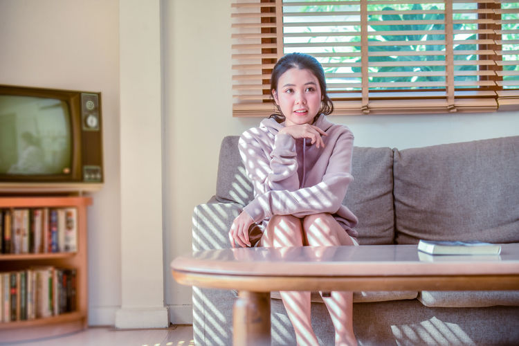 Young women sitting in room ,Beauty young women lovely happy smile,woman, sitting, sofa, couch, room, living, young, beautiful, happy, home, beauty, person, female, smile, girl, alone, casual, portrait, lifestyle, attractive, furniture, white, women, cheerful, interior, relax, background, caucasian, happiness, comfortable, sexy, cute, sit, people, barefoot, isolated, resting, modern, style, pretty, relaxing, laying, lady, looking, house, leisure, indoors, relaxation, indoor, carefree Furniture Indoors  One Person Sitting Lifestyles Women Home Interior Adult Three Quarter Length Young Adult Front View Looking At Camera Domestic Room Beauty Beauty Women Lovely Cute Girl Young Women Adult Room Sitting Smiling Relaxing Portrait Sofa Living Room Confidence  Beautiful Woman Armchair