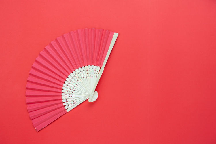 Chinese Food Moon Art And Craft Chinese New Year Close-up Colored Background Copy Space Cut Out Festival Foldable Hand Fan High Angle View Indoors  Man Made Man Made Object No People Pattern Pencil Personal Accessory Red Red Background Still Life Studio Shot White Color