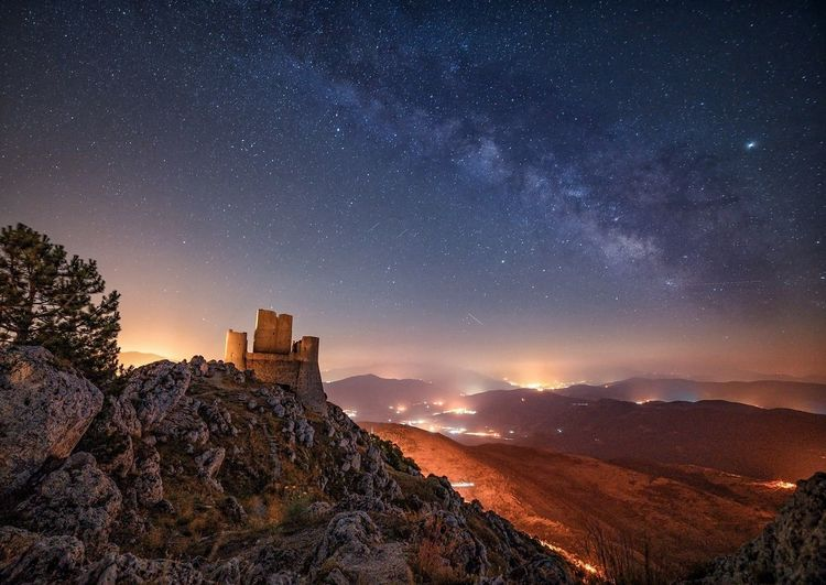 Scenic view of mountains against sky at night, this is most high castle in italy