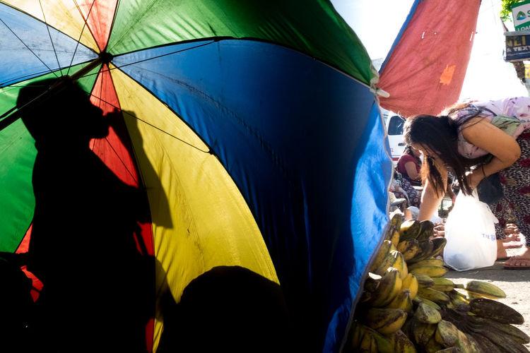 People holding multi colored umbrella