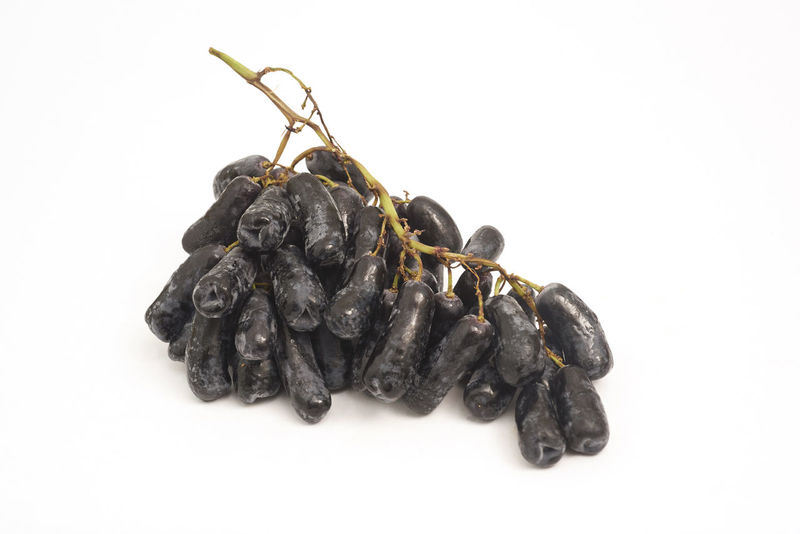 The Moon Drop grape grows in tight clusters on fleshy green stems. Their dark sapphire skin is almost black and contains just enough tannin to balance out the juicy sweet interior. The grapes are so crisp they can be snapped in two, revealing a translucent green seedless pulp. Antioxidant Australia Baby Food Cancer Cancerawareness Children Food Diet Farmer Market Farming Food Food And Drink Forest Fruit Grape Grapes Healthy Eating Nature Nutrition Nutritional Supplement Plant Research Studio Shot Wine Wine Tasting Winery