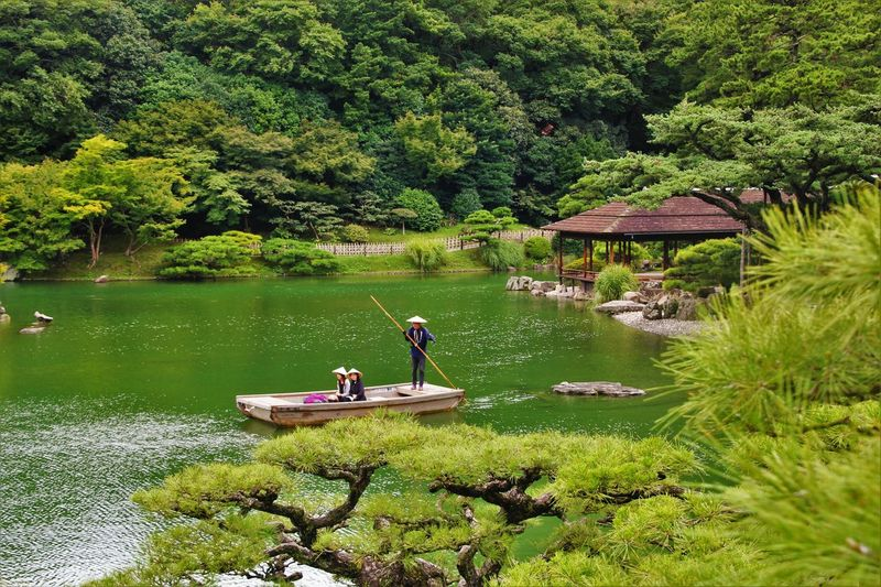 Japanese Garden Ritsurin Garden Ritsurin Garden Japan Landscape Japan Nautical Vessel Plant Tree Water Transportation Green Color Mode Of Transportation Beauty In Nature Real People Nature River EyeEmNewHere A New Beginning