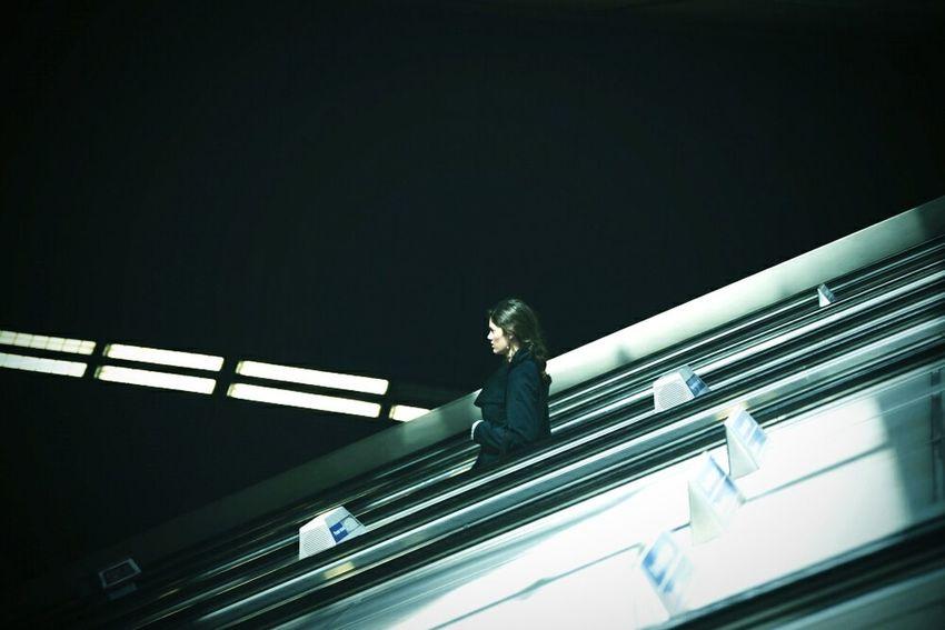 WomeninBusiness Escalator London Underground London City Life Commuting Woman Escalators Shadow And Light One Person Business Woman Alone Eye4photography  Darkness And Light Traveling Urban Lifestyle Underground London Life Street Photography