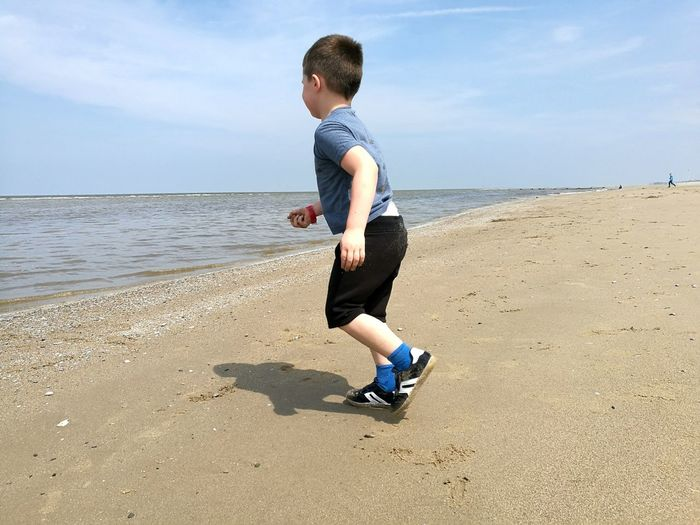 Boy Running EyeEm Selects Water Sea Full Length Beach Child Sand Healthy Lifestyle Exercising Water's Edge Childhood Coastline Sandy Beach Shore