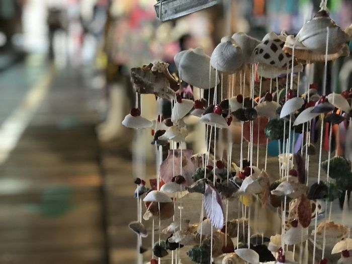 Love Thailand <3 Photo by Iphon7 PLus. Abundance Animal Animal Themes Business Choice Close-up Day Focus On Foreground Hanging In A Row Incidental People Large Group Of Objects Market Metal Outdoors Retail  Selective Focus Small Business Variation