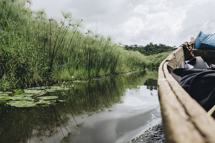 Adventure Africa African Boat Canoe Culture Day Gondola Journey Kayak Nature Outdoors Paddle Personal Perspective Plants River Sky Traditional Transportation Travel Traveling Tree Water Waterway Wooden