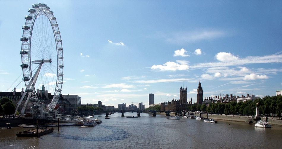 Thames river in city against sky