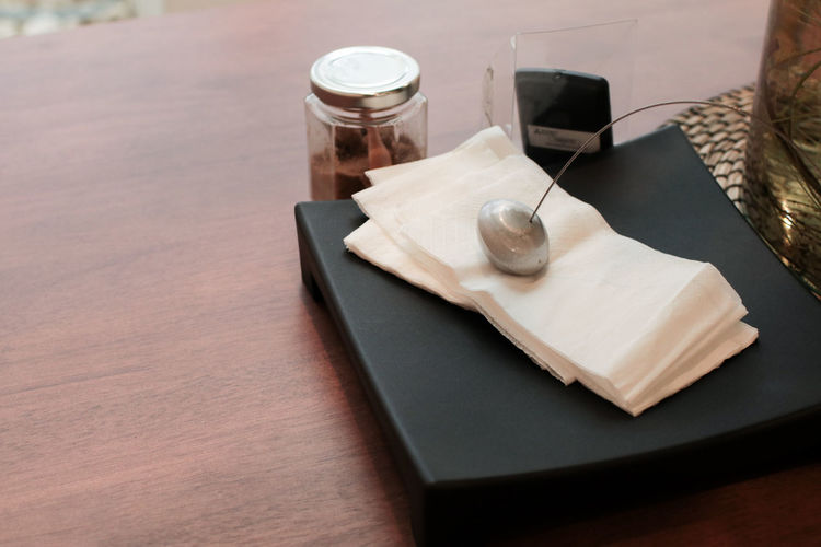 High angle view of tissue papers on table
