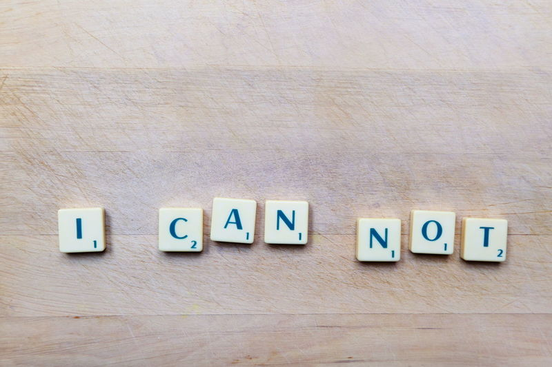 I CAN NOT text Alphabet Backgrounds Close-up Communication Day Font Game I Can Not In A Row Indoors  Motivation Motto No People Presentation Scrabble Strategy Table Text Wood - Material Letters