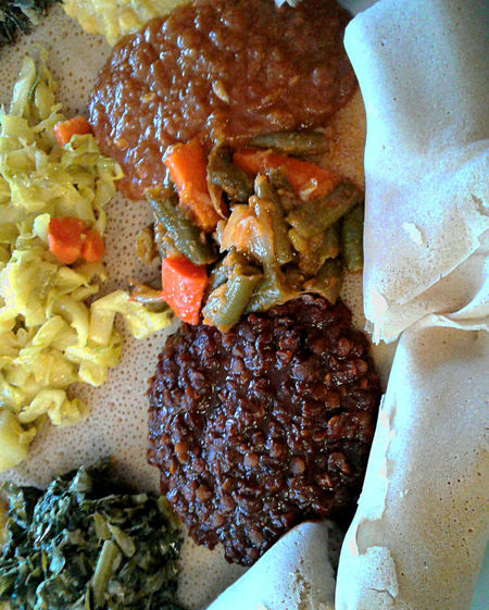 Lentils, carrots, greens, injera; spicy ethnic food and bread; healthy vegetarian food. Beautiful picture of colorful food. African Food Beautiful Food Carrots Close-up Day Dinner Ethiopian Food Food Food And Drink Freshness Healthy Eating Lentils Légumes Meal No People Ready-to-eat Spicy Food Vegan Vegetables Vegetarian Food