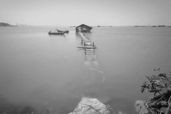 Overflow broken wooden bridge view Classic Overflow Print Architecture Beauty In Nature Blacckandwhite Black And White Bridge Built Structure Day Fog Nature No People Outdoors Scenics Sea Sky Tranquil Scene Tranquility Village Water Wooden