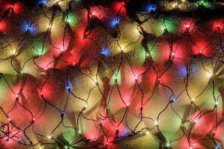 Full frame shot of illuminated christmas lights at night