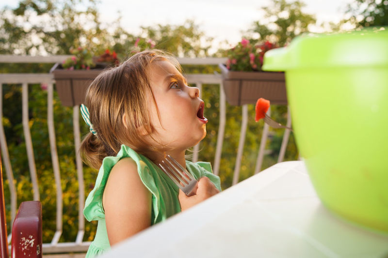 Close-up of girl eating fruit with fork
