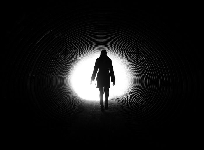Full Length Rear View Of Woman Walking In Tunnel