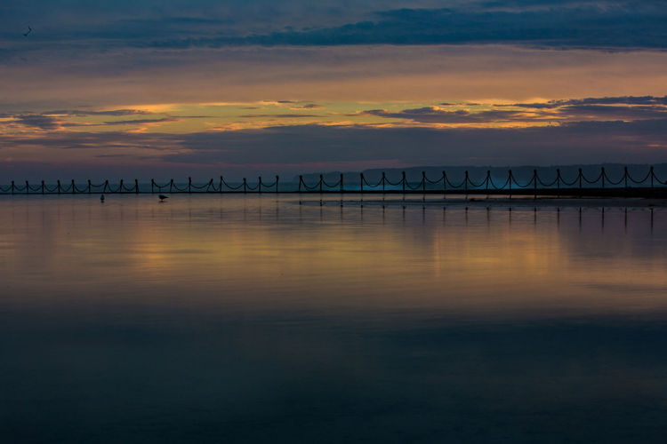Beauty In Nature Cloud - Sky Day Dramatic Sky Horizon Over Water Idyllic Nature No People Orange Color Outdoors Reflection Scenics Sea Silhouette Sky Sunset Tranquil Scene Tranquility Water