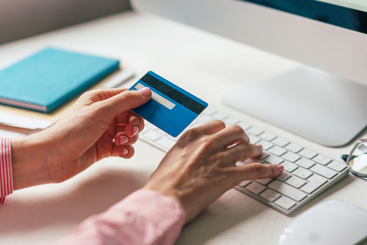 Cropped image of woman doing online payment