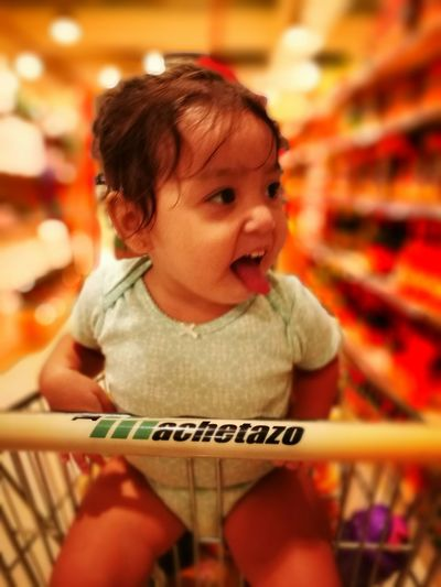 Retail  Supermarket Childhood Innocence One Person Focus On Foreground Baby Holding Toddler  Sitting Babies Only Groceries Indoors  Mouth Open Portrait Store Food And Drink People Customer  Excitement Panamá Happiness