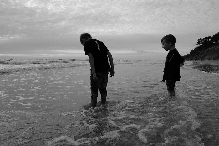 Sea Childhood Brotherhood Beach Horizon Over Water Water Sky Two People Lifestyles Boys Leisure Activity Togetherness Outdoors Nature Full Length Sand Scenics Bonding Beauty In Nature Day Welcome To Black Long Goodbye The Secret Spaces