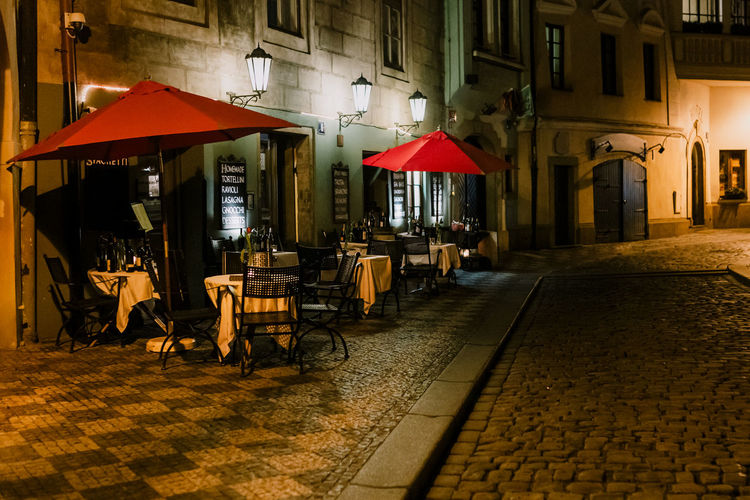 Chairs and tables in street at night