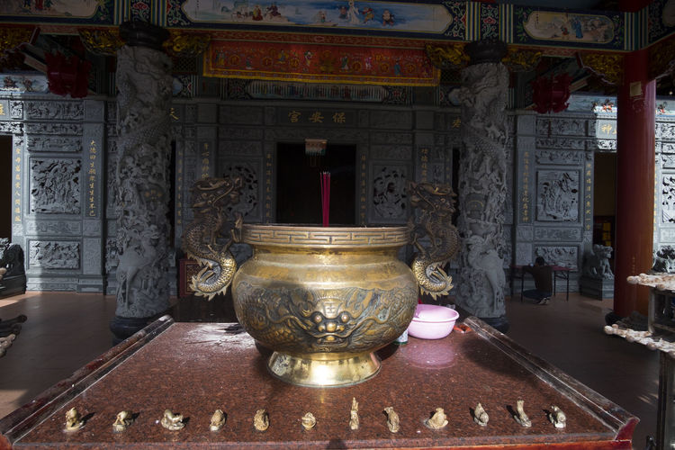 Benoa, Bali, Indonesia - January 28, 2017 : People praying and wishing a happy chinese new year on vihara satya dharma. Altar Architectural Column Architecture Art And Craft Belief Building Built Structure Craft History Indoors  No People Old Ornate Place Of Worship Religion Shrine Spirituality Statue Text