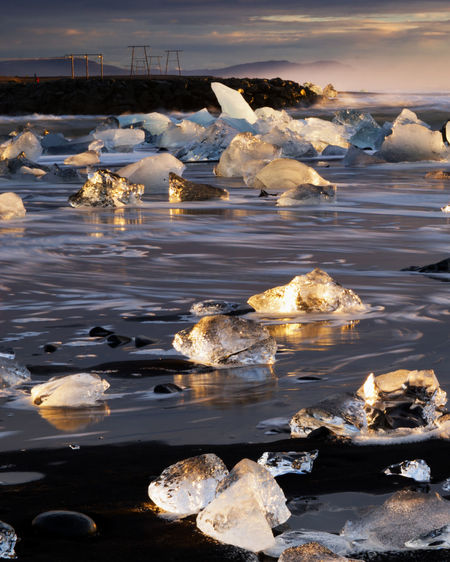 Water Ice Cold Temperature Frozen Reflection Nature Sea Beauty In Nature No People Scenics - Nature Tranquil Scene Iceberg Tranquility Sunrise Diamonds Beach Cold Landscape Iceland Wave Seascape Tourist Destination Natural Wonder