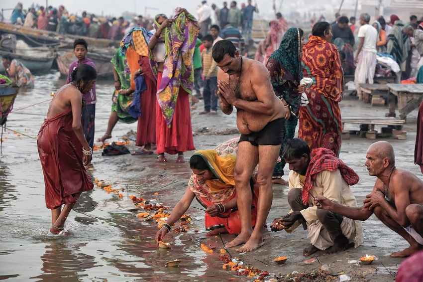 Morning bathe at the Raj Ghat in Varanasi Uttar Pradesh. January 22, 2017. Cultures Large Group Of People People Streetphotography Documentary EyeEm Best Shots - People + Portrait Street Photography Ganges River Travel People Photography India Lifestyles Real People Storytelling Check This Out Travel Photography Indian Varanasi Incredible India