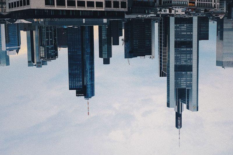 Tilt image of building against sky