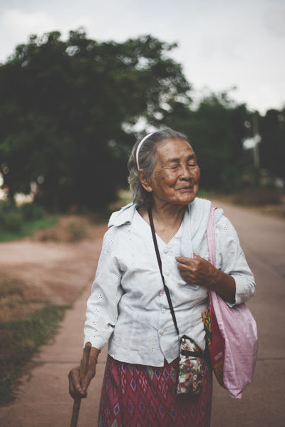 Casual Clothing Cute Day Elder Elderly Focus On Foreground Full Length Jacket Leisure Activity Lifestyles Old Woman Outdoors Person Portrait Thai Thailand Tree Warm Clothing