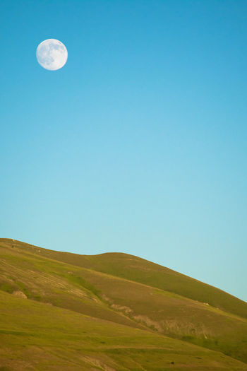 Moonrise Blue Nature Rural Scene Agriculture Sky Beauty In Nature No People Landscape Outdoors Moon Scenics Backgrounds Day Moon Moonrise Montains    Castelluccio The Great Outdoors - 2017 EyeEm Awards