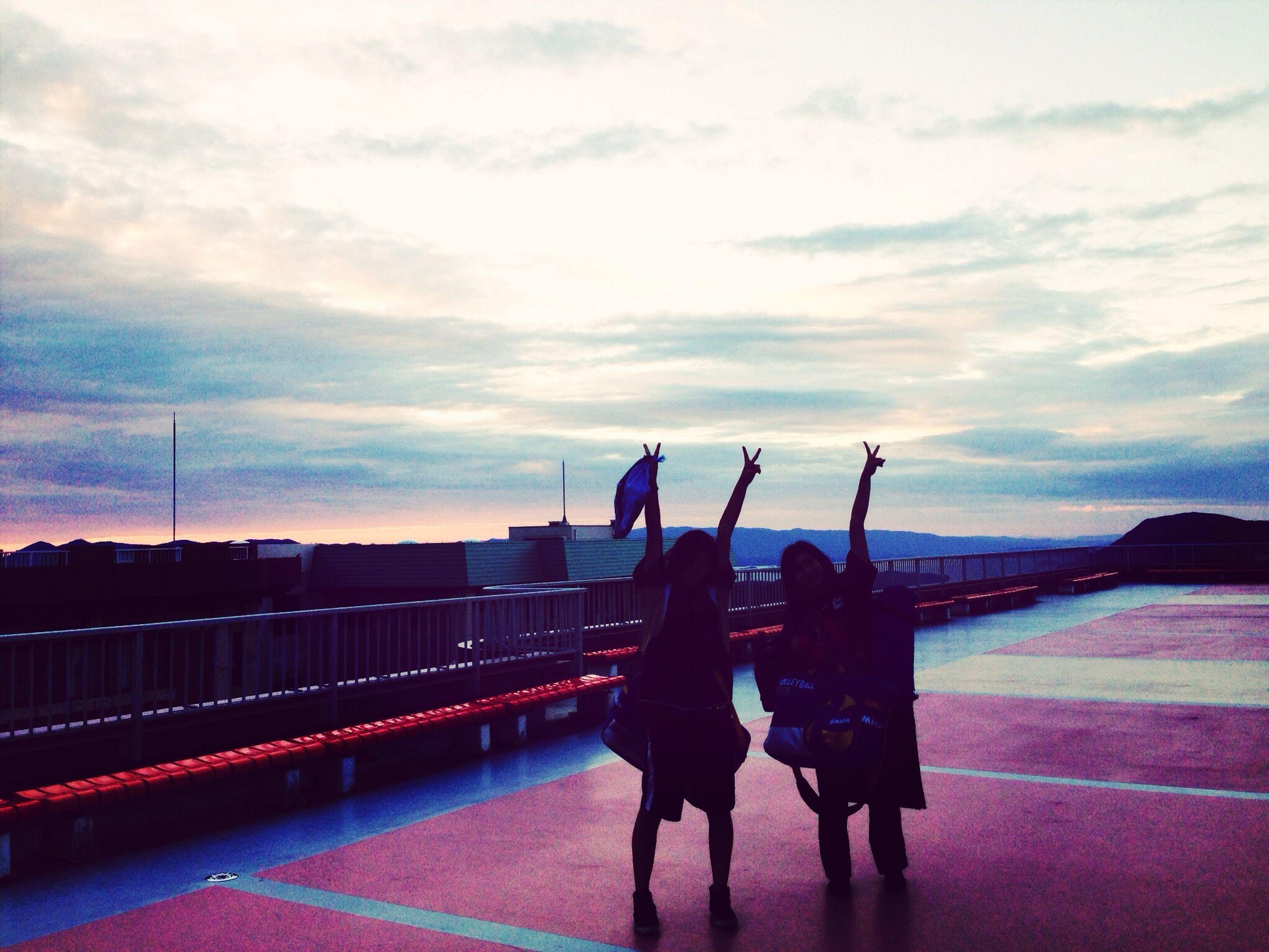 men, sky, lifestyles, leisure activity, person, transportation, cloud - sky, silhouette, railing, rear view, standing, sunset, built structure, full length, cloud, dusk, bridge - man made structure
