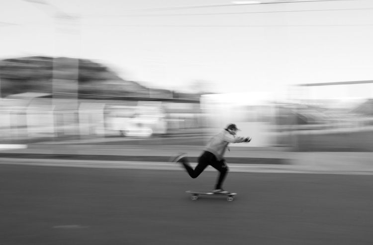 Speed Blurred Motion Motion Real People Running Full Length One Person Lifestyles Transportation Long Exposure Road Skill  Sport Leisure Activity Outdoors Healthy Lifestyle Day Exercising Sports Clothing People Skatelife Longboarder Longboards Sports Longboard Breathing Space The Week On EyeEm Done That. Black And White Friday