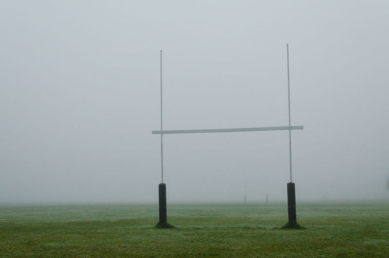 Fence on field against sky