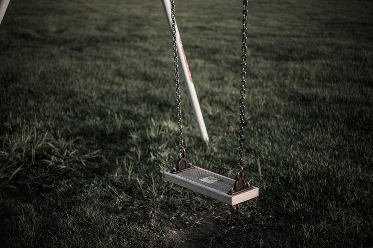 Swing over grassy field in park
