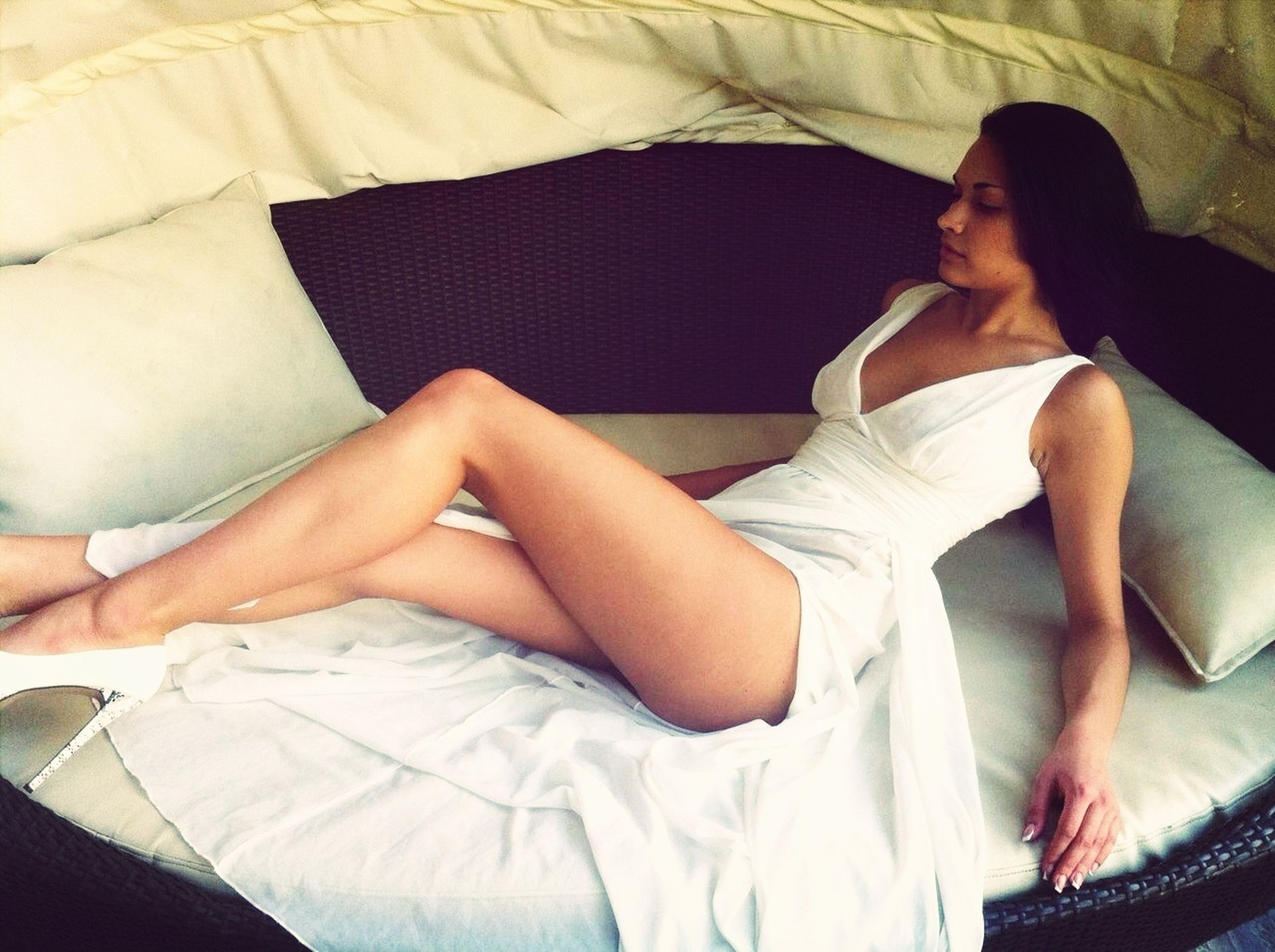 indoors, bed, young adult, relaxation, lifestyles, young women, sitting, bedroom, sofa, person, resting, lying down, home interior, casual clothing, leisure activity, sleeping, comfortable, togetherness