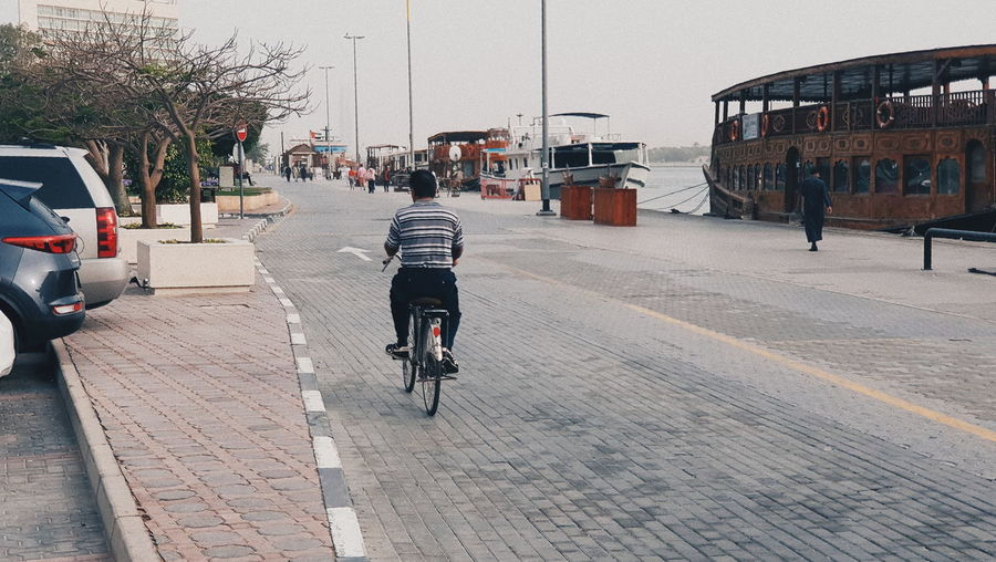 Transportation Bicycle Land Vehicle Mode Of Transportation City Architecture Building Exterior Built Structure Real People Street Rear View Men Ride One Person Riding Sport Cycling Motor Vehicle Lifestyles The Way Forward Outdoors