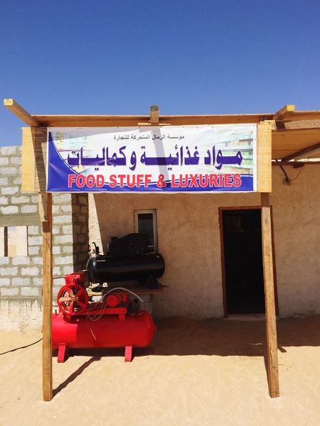 Desert Shopping In The Middle Of Nowhere Shop Sign Shop Front Shop Text Communication Day Outdoors Architecture Built Structure Sunlight No People Clear Sky Blue Building Exterior