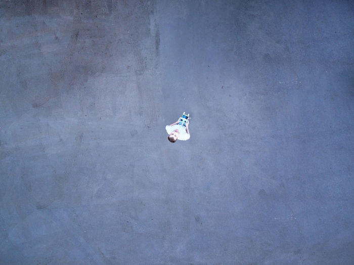 Alone Asphalt Drone  Man Minimalist Asphaltography Concept Conceptual Day High Angle View Joy Minimal Minimalism No People Outdoors Parking Self Portrait Selfie Street Tongue AI Now