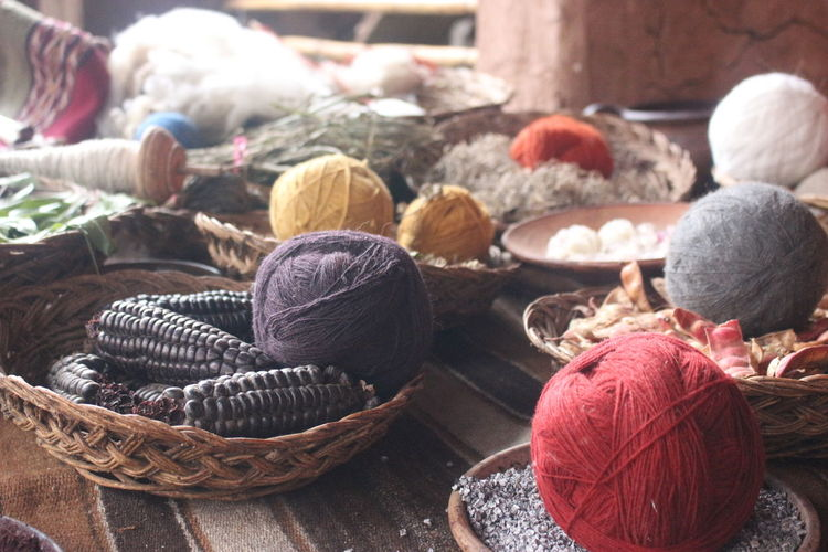 Close-Up Of Colorful Threads With Food For Sale At Market