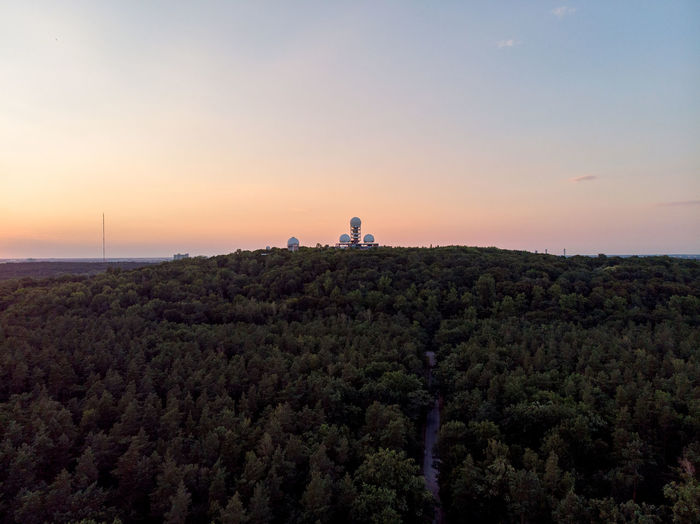 Teufelsberg Relaxation Droneshot Sky Scenics - Nature Nature Sunset Tranquil Scene Tree Tranquility Architecture Built Structure Growth Landscape Non-urban Scene Building Exterior Environment Idyllic Outdoors Real People Historical Monuments Communications Tower Capital Cities  Famous Place Forest My Best Photo