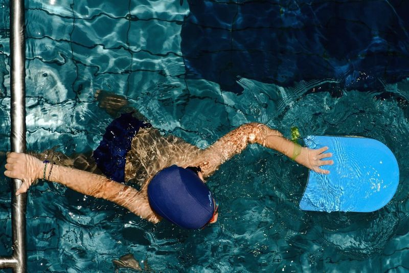 High Angle View Of A Boy In Swimming Pool