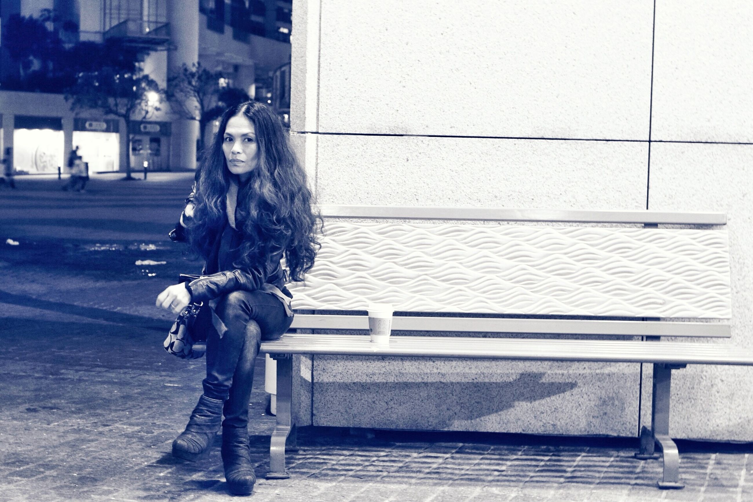 full length, casual clothing, lifestyles, building exterior, person, leisure activity, elementary age, built structure, childhood, architecture, standing, street, side view, sitting, looking away, girls, day, young adult