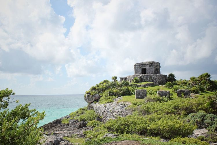 Scenic View Of Sea In Tulum Against Cloudy Sky