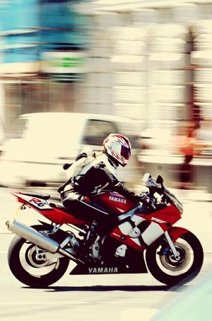 Speed Headwear Crash Helmet Sports Race Blurred Motion Helmet Sports Helmet Competition Motorcycle Motion Riding Excitement Motor Racing Track Sport One Person Land Vehicle Competitive Sport Motorsport Professional Sport Day