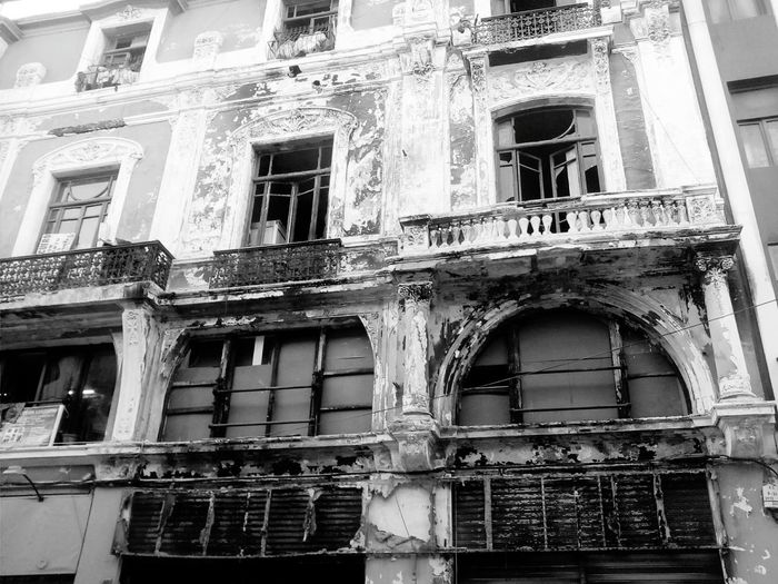 Buildings Burned Building Story No People Balcony Low Angle View Building Exterior Window Architecture Built Structure Damaged Abandoned Outdoors Weathered No People Low Angle View Obsolete Day Bad Condition Balcony